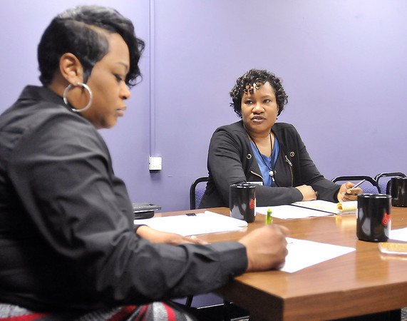 John P. Cleary | The Herald Bulletin<br /> Mary Baker-Boudissa, an employment coach for United Way, works with the Impact Center. Here during a staff meeting Mary, right, discusses items with Impact Center executive director Sherry Peak-Davis.