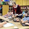 John P. Cleary    The Herald Bulletin<br /> Eastside Elementary School fifth-grade teacher Jeri Tarvin assists this student as the class works on their math problems before the holiday break.  ACS proposes moving fifth-graders to a new intermediate school to be located in the former Eastside Middle School building.