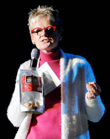 Don Knight |  The Herald Bulletin<br /> Cindy Dunston Quirk tries a Vanilla Bite Dog Treat during her pitch for Scout & Zoe's at Mainstage Theatre on Thursday.