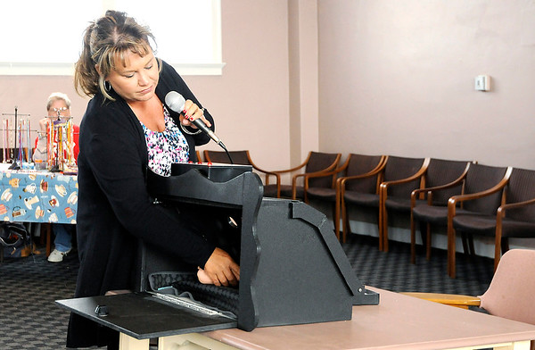 File photo | The Herald Bulletin<br /> Monica Kelsey demonstrates a Safe Haven Baby Box at the Newman Events Center in this file photo from 2016. The box notifies 911 when a baby is placed inside.