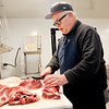 John P. Cleary | The Herald Bulletin<br /> Horner's Midtown Market owner Verlin Horner could be found in the back of his new store cutting meat for a customer on the opening morning of the Alexandria market. This is Horner's third store with one in Marion, Fairmount and now Alexandria.