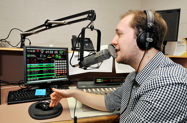John P. Cleary |  The Herald Bulletin<br /> Pendleton Heights High School's WEEM-FM radio station has been named a finalist for national award.  Senior Sam Bannon broadcasts from one of the radio station's studios.