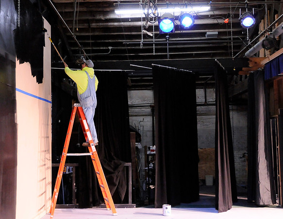 Don Knight |  The Herald Bulletin<br /> Andy Persinger paints the stage at Mainstage Theatre on Saturday. Mainstage held a cleanup day in preparation for the 2018 season.