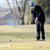 Don Knight |  The Herald Bulletin<br /> Scott Wareham putts on the ninth green at Grandview Golf Course as he takes advantage of the unseasonable warm weather on Friday.
