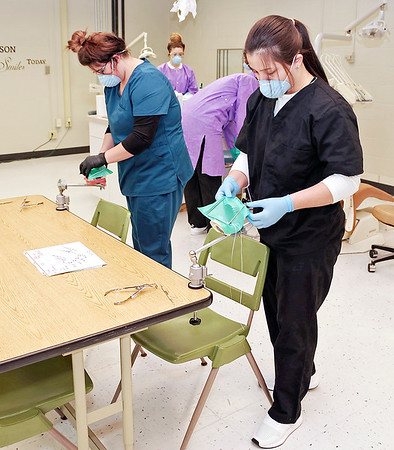 Mark Maynard   For The Herald Bulletin<br /> Cassady McCord and Selenna Estrada practice installing dental dams during their Dental Careers class at Anderson's D26 Career Center.