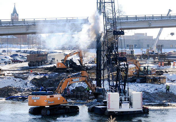 Don Knight |  The Herald Bulletin<br /> A piling is installed as construction of the west bound span of the Eisenhower bridge continues on Wednesday.