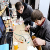 Don Knight |  The Herald Bulletin<br /> From left, Dylan Alkire and Lucas Gibbons work on a lab assignment testing a proximity sensor with different materials at Purdue Polytechnic in Anderson on Thursday.