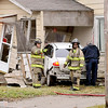 John P. Cleary | The Herald Bulletin<br /> Anderson firefighters check out the scene after this vehicle lost control Thursday morning while driving west along Eighth Street breaking off a power pole, hitting a fire hydrant before ending up into this house at 2112 West Eighth Street.
