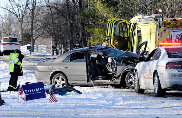 Don Knight |  The Herald Bulletin<br /> The Madison County Sheriff's Department investigates a serious accident in the 7000 block of West 8th Street Road on Saturday.