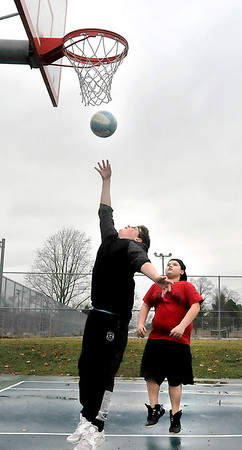 John P. Cleary | The Herald Bulletin<br /> Zach Grider, 14, puts up a shot while playing basketball with his friend Malachi Honda, 13, at Pulaski Park. With temperatures reaching the mid-50's, and the rain stopped, Monday afternoon was a good time to get outside and get some fresh air.