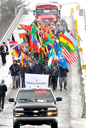 John P. Cleary | The Herald Bulletin<br /> Anderson University held a Peace & Justice March Monday marching from the Paramount Theatre to Reardon Auditorium carrying International flags that represent the many countries that makeup the AU student body.