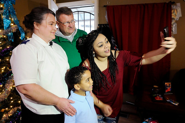 Don Knight |  The Herald Bulletin<br /> Pamela Graves and her son Lamar pose for a selfie with Beth Stamper from the Salvation Army of Henry County and Randy Howard from Hoosiers with Hearts on Wednesday.