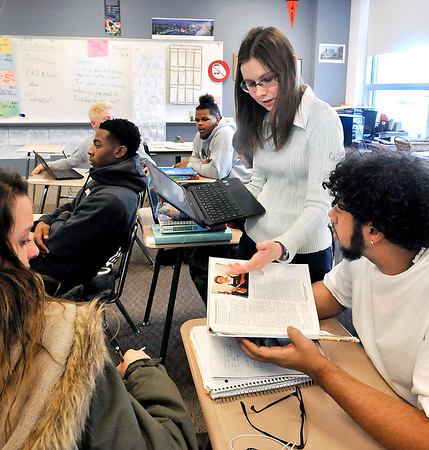 John P. Cleary | The Herald Bulletin<br /> Anderson High School teacher Lydia Ivy works with students in her Senior Economics class Tuesday.