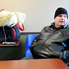 Don Knight |  The Herald Bulletin<br /> Mike Burke warms up at The Christian Center on Tuesday. Burke recently became homeless and spent a cold night in his truck Monday before coming to The Christian Center.