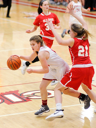 Don Knight |  The Herald Bulletin<br /> Frankton's Grace Alexander drives as she is guarded by Mississinewa's Halle Planck on Tuesday.