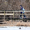 John P. Cleary | The Herald Bulletin<br /> As the temperatures, and snow flakes fall, these joggers hit the trail to get their run in around Killbuck Wetlands Monday afternoon.