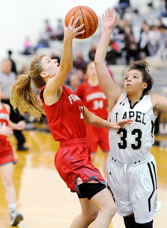 Don Knight    The Herald Bulletin<br /> Frankton's Sydney Tucker drives for a layup as Lapel's Delany Peoples attempts to block her shot during the Girls Madison County Basketball Tournament championship at Lapel on Friday.