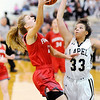 Don Knight |  The Herald Bulletin<br /> Frankton's Sydney Tucker drives for a layup as Lapel's Delany Peoples attempts to block her shot during the Girls Madison County Basketball Tournament championship at Lapel on Friday.