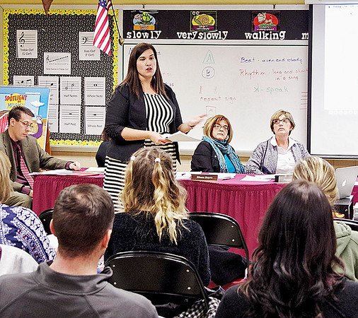 Mark Maynard | for The Herald Bulletin<br /> During the 1028 hearing held at the Alexandria-Monroe Elementary School, Belvia Gray of H. J. Umbaugh & Associates details the projected financial implications of the various facilities options.
