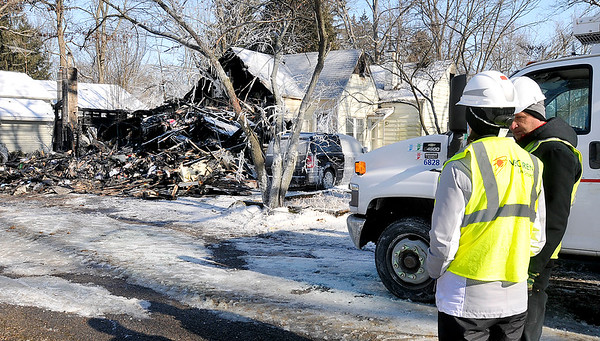 John P. Cleary | The Herald Bulletin<br /> Vectren Energy personnel was on the scene on Grandview Drive in Camp Chesterfield Wednesday after an overnight fire destroyed the back part of this structure.