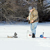 John P. Cleary |  The Herald Bulletin<br /> This angler takes advantage of the double-digit temperatures and bright sunshine Thursday to get out on the ice for a little fishing at Shadyside Lake.<br /> Temps are to get below zero overnight with a Wind Chill Advisory out until 11:00 a.m. Friday morning.