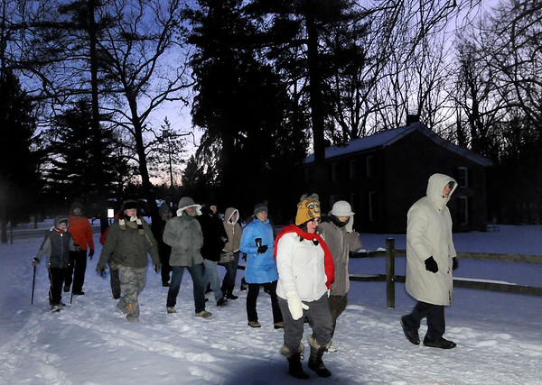 Don Knight |  The Herald Bulletin<br /> Hikers pass the Bronnenberg House on their way back to the Nature Center during the First  Day hike at Mounds State Park on Saturday.
