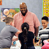 John P. Cleary | The Herald Bulletin<br /> Anderson Elementary third-grade teacher Ryan Miller works with is students on lessons about Dr. Martin Luther King Jr. this past week. Miller will be the keynote speaker for a school-wide assembly honoring King.