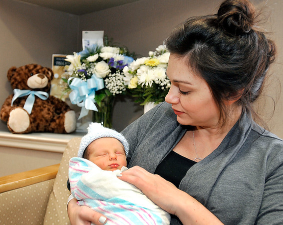 John P. Cleary |  The Herald Bulletin<br /> Ashley Grounds holds her newborn son, Boone, Wednesday afternoon at St. Vincent Anderson where he was the first Madison County baby born in the new year arriving at 12:44 a.m. Jan. 2, 2018. Boone came into the world weighing 6 lb, 12 oz, and was 20 1/2 inches long. The father, Zach Grounds and Ashley are from Pendleton.  This is Ashley's first child and Zach's second.