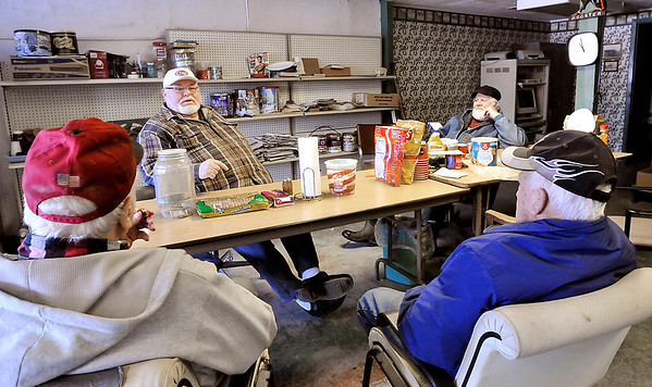 John P. Cleary |  The Herald Bulletin<br /> Retirees gather daily at the Alexandria Feed & Supply. Steve McPhearson, second from left, talks with Richard Howard, background right, and Richard Thompson, front left, and Jack Barber, front right, Tuesday morning at the Alexandria Feed & Supply.