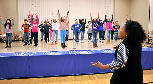 John P. Cleary | The Herald Bulletin<br /> Anderson Elementary fourth-grade teacher Christine Brown watches students go through their dance routine as they rehearse for a school-wide assembly honoring Dr. Martin Luther King Jr.