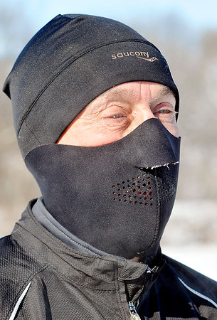 John P. Cleary |  The Herald Bulletin<br /> Steve Younce, of Alexandria, layered up as he jogged around Shadyside Park Tuesday morning in the sub-zero temperatures.