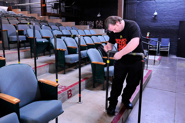 Don Knight |  The Herald Bulletin<br /> Garrett Ogle-Short removes stickers from new hand rails so they can be painted at Mainstage Theatre on Saturday. Mainstage held a cleanup day in preparation for the 2018 season.