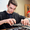 John P. Cleary | The Herald Bulletin<br /> Elwood High School junior James Dobbs replaces a circuit board in a student's Cromebook as a member of the school's Tech Team.
