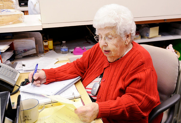 Don Knight |  The Herald Bulletin<br /> Martha Lou Laughlin works at the front desk and keeps up the books as a volunteer at St. Vincent de Paul on Thursday.