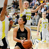 Don Knight | The Herald Bulletin<br /> Lapel's Delany Peoples drives to the basket against Shenandoah's Erikka Hill and Jenna Stewart as the Raiders hosted the Bulldogs on Thursday.