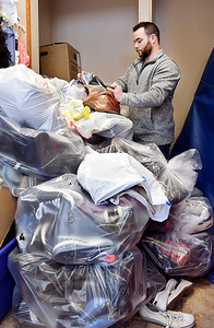 John P. Cleary | The Herald Bulletin Alexandria Community Center's executive director Andrew Sovern goes through some of the more than 1,000 pairs of shoes that they have collected as a fund-raiser for the Alexandria baby pantry.