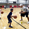 John P. Cleary | The Herald Bulletin<br /> Ben Gibbs Ben Gibbs gives instructions to Kendall Brown, 9, during his Winter Skills Camp for youth at the Youth Center field house Wednesday.