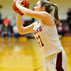 Don Knight | The Herald Bulletin<br /> Alexandria's Kirsten VanHorn shoots as the Tigers hosted Madison-Grant on Thursday.
