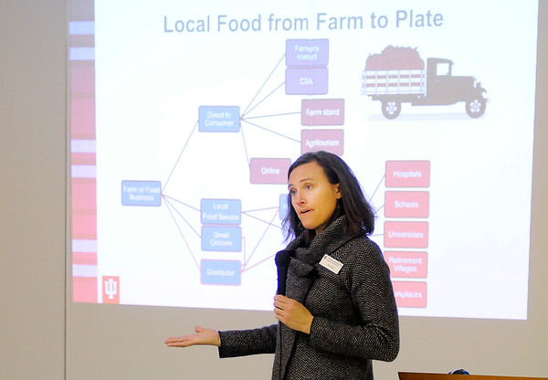 Don Knight | The Herald Bulletin<br /> Jodee Ellett from Indiana University talks about the different ways local food gets distributed as the Madison County Local Food Network held their first summit at the Anderson Impact Center on Thursday.