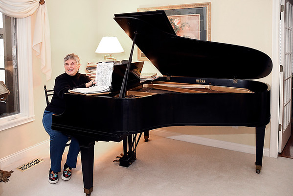John P. Cleary | The Herald Bulletin<br /> Sonya Eddy retired as director of the Madison County Music Makers after 55 years, goes over music at her grand piano.