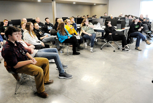 Don Knight   The Herald Bulletin<br /> Knightstown, Muncie and Anderson Robotics teams learn about their challenge for this year's competition at Purdue Polytechnic on Saturday. The teams have six weeks to build their robots.