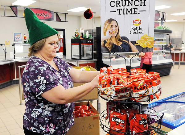 Don Knight | The Herald Bulletin<br /> Brenda Roberts restocks the chip supply between lunches at Highland Middle School on Friday.