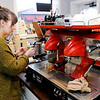 Don Knight | The Herald Bulletin<br /> Whitney Monize froths milk while making a cappuccino at Jackrabbit Coffee on Friday. The coffee shop located on west 11th Street was celebrating their one year anniversary and participating in the Art Walk.