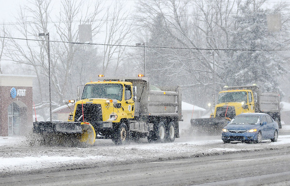 Don Knight | The Herald Bulletin<br /> A pair of INDOT plows clear southbound lanes of Scatterfield on Saturday.