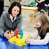 Don Knight | The Herald Bulletin<br /> NTN HR manager Teresa Amburgey plays Rock 'Em Sock 'Em Robots with Zoey Burns during the opening of the new awards room at Anderson Elementary on Wednesday.