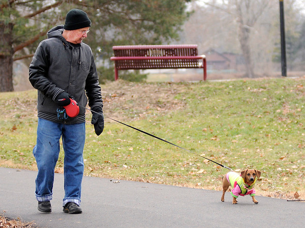 Don Knight   The Herald Bulletin<br /> Mike Bondurant walks his dachshund Charlie around Shadyside park on Friday. Bondurant walks Charlie a couple times a day and says she just loves it.