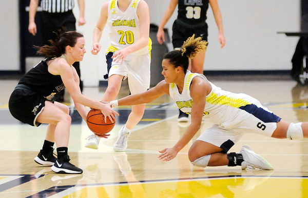 Don Knight | The Herald Bulletin<br /> Shenandoah's Erikka Hill forces a jump ball as her and Lapel's Kylie Rich grab for a loose ball as the Raiders hosted the Bulldogs on Thursday.