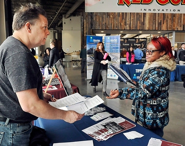 John P. Cleary | The Herald Bulletin Ted Martin of Morales Group talks with Ashanti Thompson as he looks over her resume during the Hire Anderson Job Fair Friday at Purdue Polytechnic.