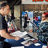 John P. Cleary | The Herald Bulletin<br /> Ted Martin of Morales Group talks with Ashanti Thompson as he looks over her resume during the Hire Anderson Job Fair Friday at Purdue Polytechnic.