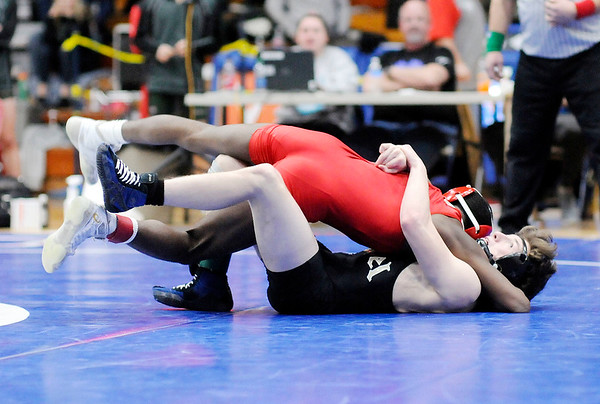 Don Knight   The Herald Bulletin<br /> Anderson's Willie Dennison wins by fall in overtime against Lapel's Harrison Hadley in the 120 pound final during the wrestling sectional at Elwood on Saturday.
